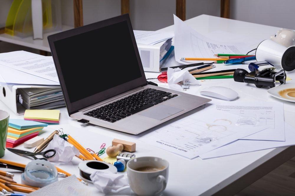 messy desk laptop computer